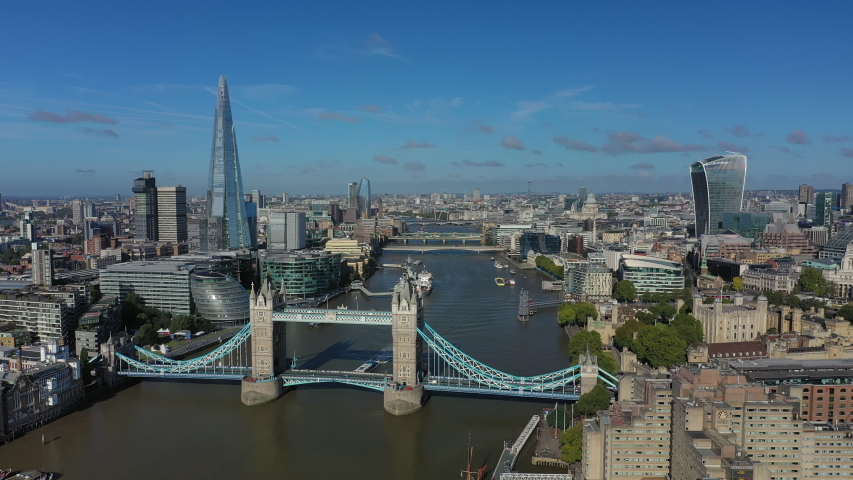 Aerial view of cityscape of London, Tower Bridge, Tower of London, skyline with famous skyscraper The Shard, clear blue sky - panorama of capital city of United Kingdom from above,Great Britain,Europe #1036878767