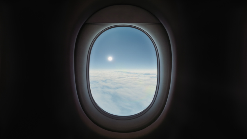 Airplane Window View Above the Clouds, Blue Sky