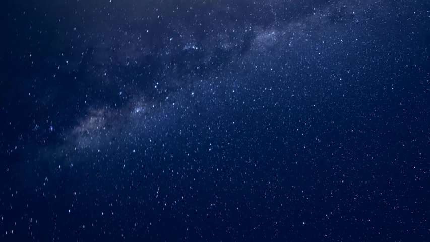 Night milky way time lapse, starry sky in summer clean night, beautiful colours in horizon.