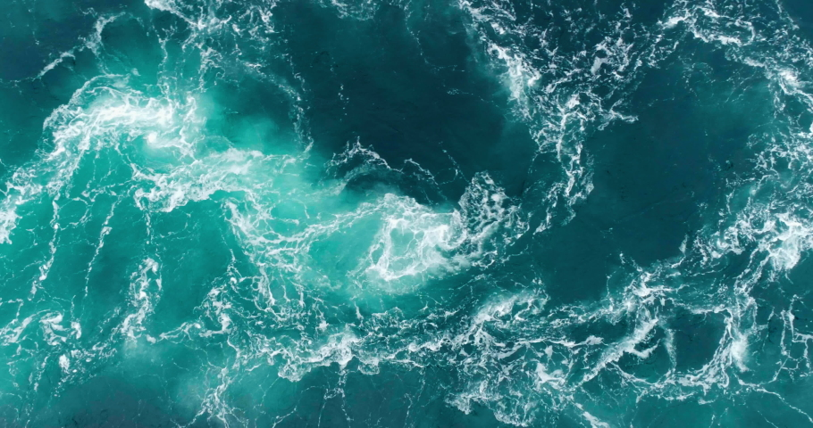 4K drone video with birds-eye view of the abstract and powerful water currents, rapids and whirlpools of the worlds larges maelstrom Saltstraumen in Bodø, Norway. Royalty-Free Stock Footage #1036929425
