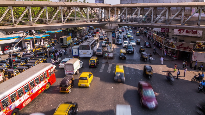 Mumbai, India - March 19, 2014 : Busy traffic below Bandra West Skywalk time lapse