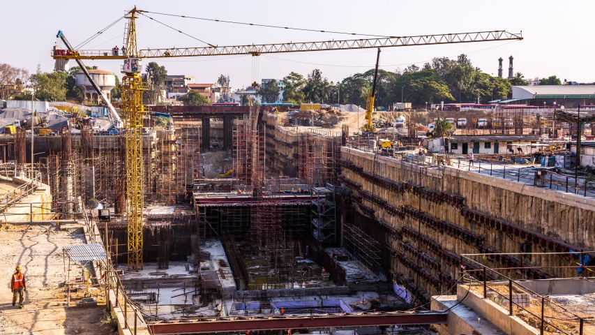 Bangalore, India - March 27, 2014 : Underground Metro line construction at Kempegowda Station Majestic in Bangalore downtown, India time lapse