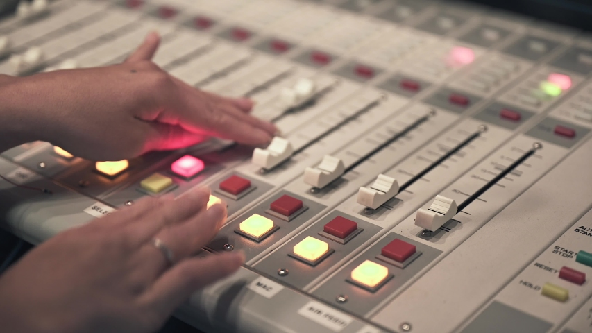The Female Hand Moves The Fader Knob On The Sound Mixing Console close up shot | Shutterstock HD Video #1036963091
