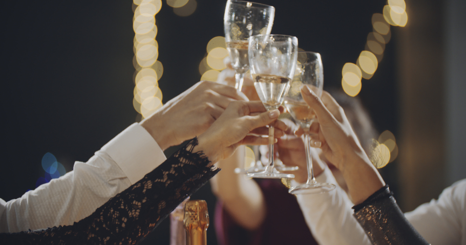 Group of stylish friends gathering together and celebrating at glamorous night party event, making toast, drinking alcohol. Diversity of multiracial communication. Friendship, lifestyle, fun concept. Royalty-Free Stock Footage #1036972334