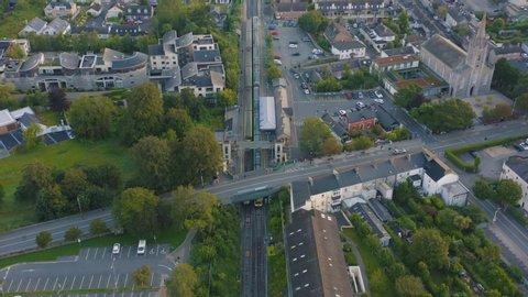 Aerial view, 4K, train leaves Malahide Station, Ireland.