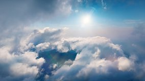 Flying through heavenly beautiful sunny cloudscape. Amazing timelapse of white fluffy clouds moving softly on the sky and the sun shining above the clouds with beautiful rays and lens flare.