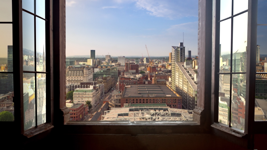 Manchester city timelapse day to nigh seen through a window high point of view uk england