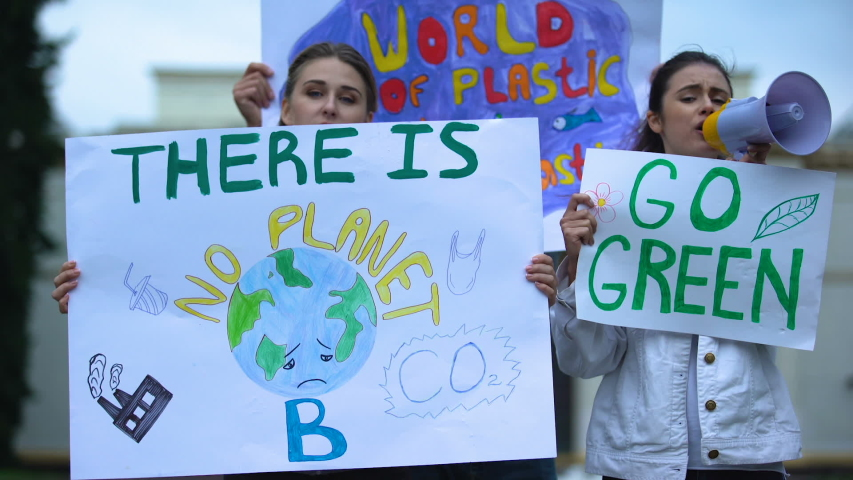 Ecologists with banners shouting in megaphone about pollution, global warming | Shutterstock HD Video #1037020307