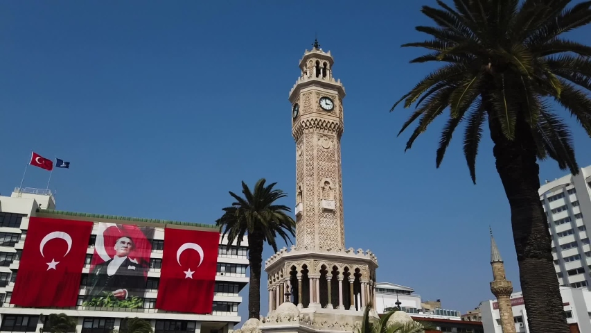 Izmir Clock Tower is a historic clock tower located at the Konak Square in the Konak district of Izmir, Turkey.   Shutterstock HD Video #1037024729