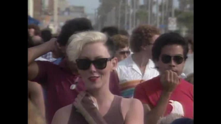 CIRCA 1984 - Street performers are shown in Venice Beach in California.
