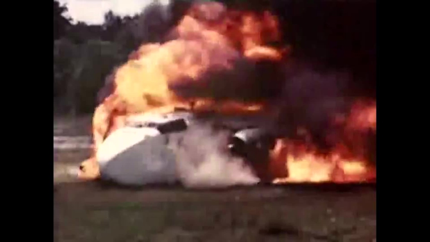 CIRCA 1952 A plane with low volatility fuel crashes and catches fire, and engines and propellers continue to spin after the crash.