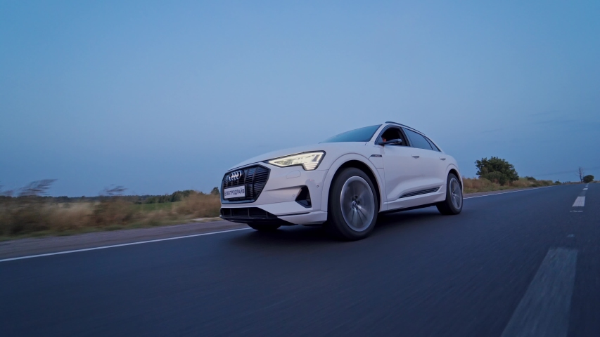 VINNITSA, UKRAINE - September 2019: Audi e tron profile view. Audi e tron, a fully electric car on highway