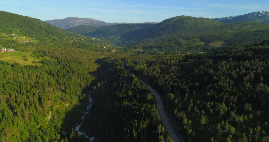 Aerial: Drone approaching motor home moving on country road amidst green trees in forest - Borgund, Norway   Shutterstock HD Video #1037053133