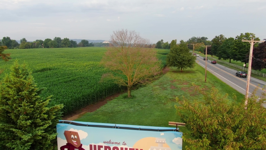 Hershey , Pennsylvania / United States - 08 21 2019: Reverse dolly shot, Billboard sign advertising Sweetest Place on Earth