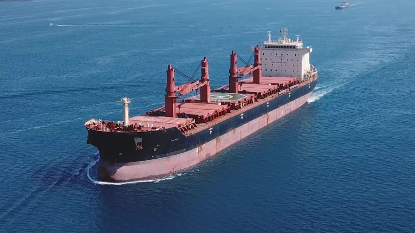 Aerial a cargo ship sailing northbound on Straits Bosporus. A bulk carrier or bulker is a merchant ship specially designed to transport unpackaged bulk cargo, such as grains, ore, coal or timber