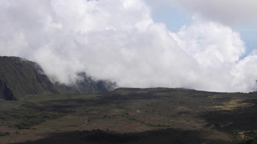 Clouds blow along rock surface of Pas des Sables, Reunion Island. Timelapse.   Shutterstock HD Video #1037060585
