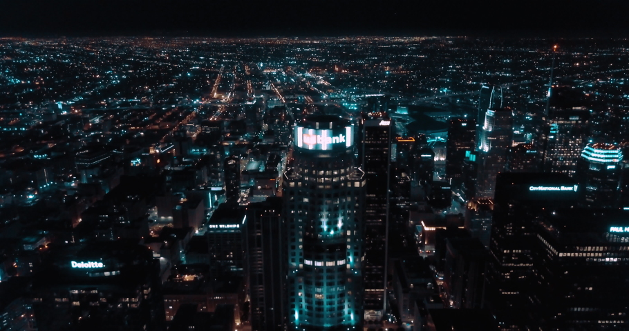 Cinematic Aerial flyover of Downtown Los Angeles Skyline at Night - 4K | Shutterstock HD Video #1037066000