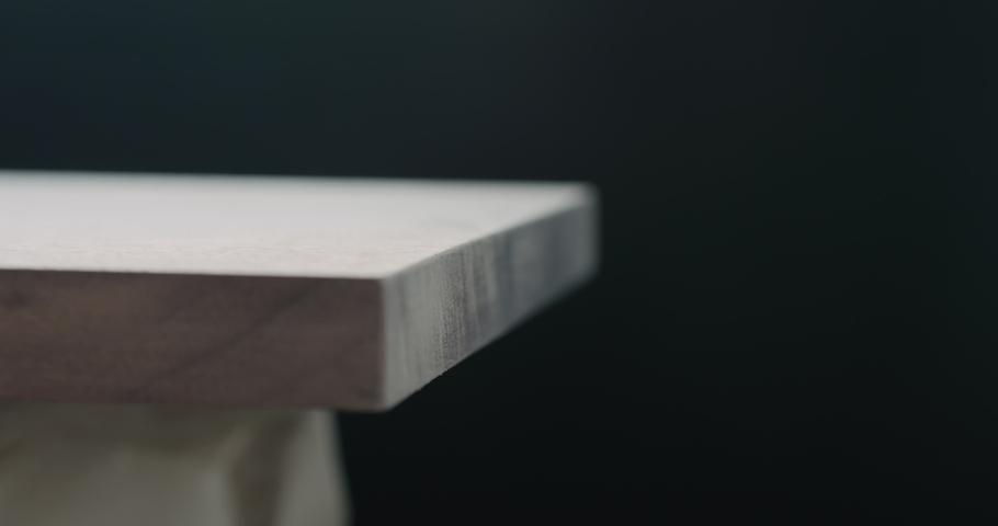 Slow motion woodworker hand sanding walnut board with sand sponge | Shutterstock HD Video #1037091992