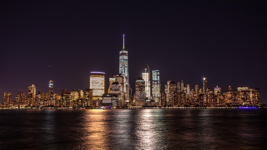 New York, USA - September 22, 2016 : Lower Manhattan, Wall Street view from New Jersey time lapse at night | Shutterstock HD Video #1037096210