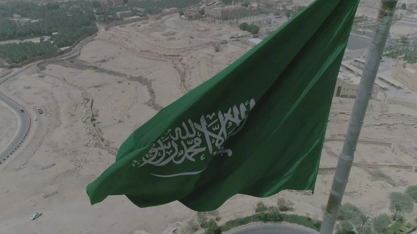 Saudi Arabia National Day showing flag in the sky with up view for the flag | Shutterstock HD Video #1037102069