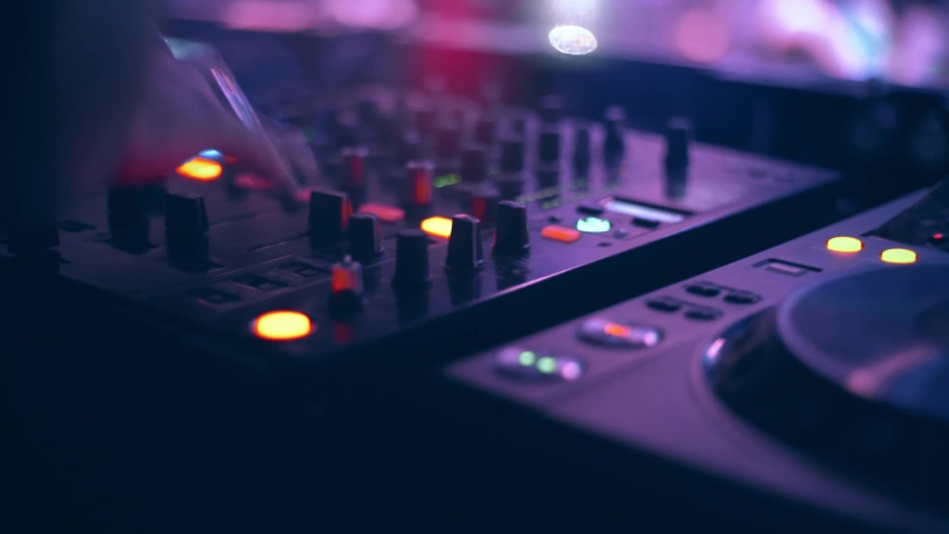 DJ mixing in the mixer, people feeling the vibration of the music   Shutterstock HD Video #1037112929