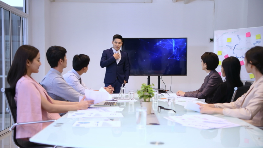 Business concepts. The young man was accepted by colleagues at the meeting.  4k Resolution. Royalty-Free Stock Footage #1037140709