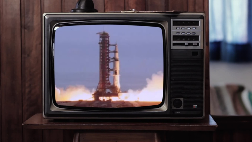 Apollo 11 Rocket Launch in an Old Vintage TV. Blue Dark Tone. Elements of this Image Furnished by NASA.