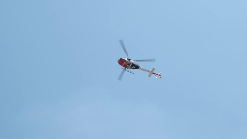 Ribeirão Preto, São Paulo / Brazil - Circa September 2019: Sao Paulo State Military Police helicopter flying over the city of Ribeirão Preto.