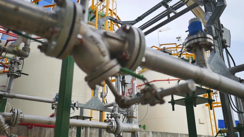 Complex engineering of Oil or chemical storage tank in petrochemical refinery industry plant in petroleum and heavy industrial plant , Panning video | Shutterstock HD Video #1037158295