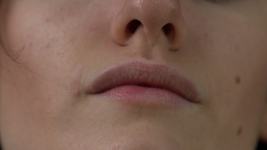 Closeup shot of a womans mouth and nose, completely natural without makeup. | Shutterstock HD Video #1037158772