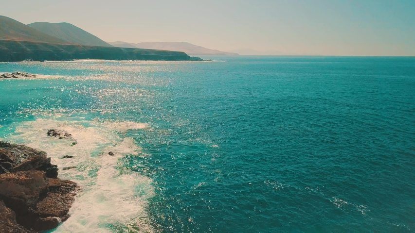 Aerial shooting panoramic birds eye view on sea waves, Canary islands. Seascape coastline at sunny day. Travel, Beach, Nature, freedom concept. | Shutterstock HD Video #1037162828