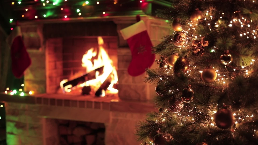 Christmas decorated tree closeup with fireplace interior