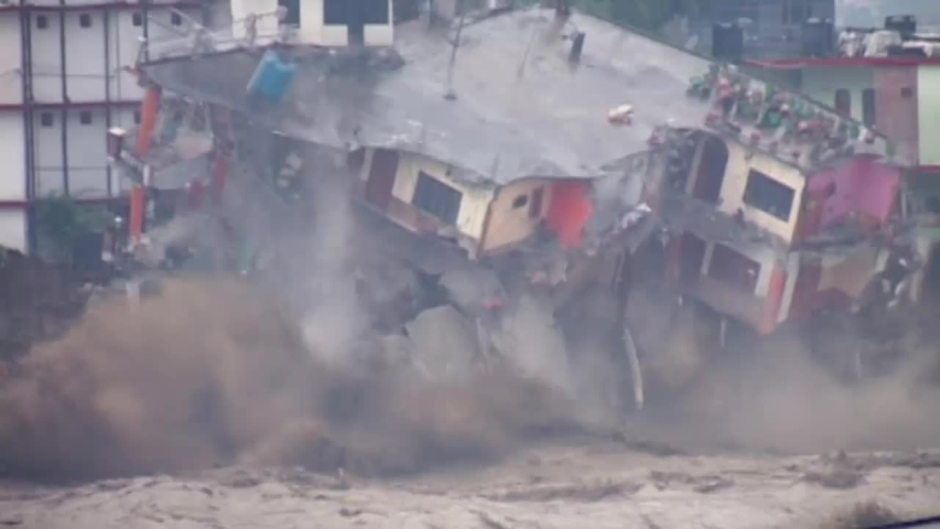 landslide, flood, cloudburst in india 2013 , killed six to seven thousand pilgrims . Three story building collapsed in Ganga river.