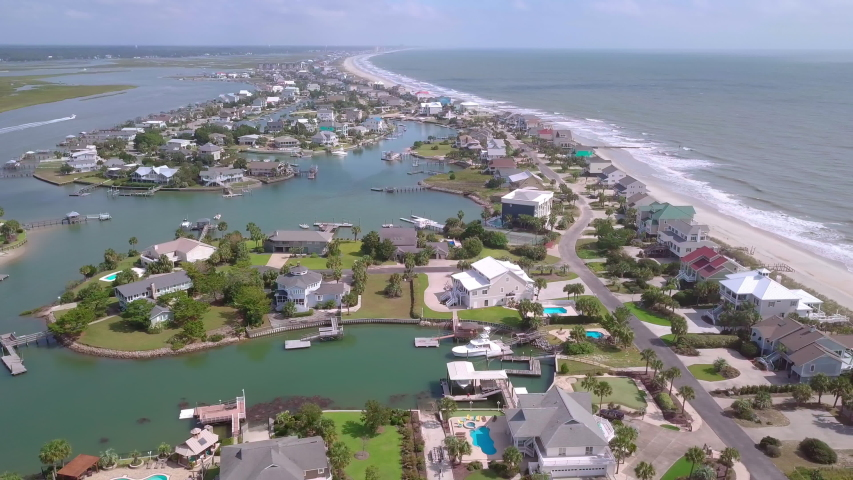 Aerial flyover of expensive waterfront homes in Surfside Beach near Myrtle Beach, South Carolina.