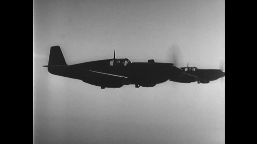 CIRCA 1940s- American fighter jets drop bombs over Hungary and Berlin during WWII.