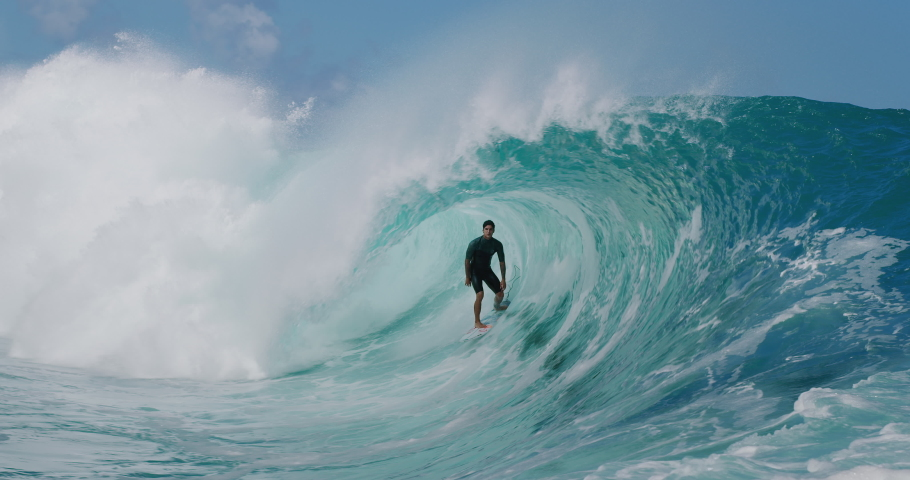 TEAHUPOO, TAHITI - August 17, 2019: SLOW MOTION - Professional surfer Gabriel Medina stands up tall in amazing Teahupoo barrel in slow motion