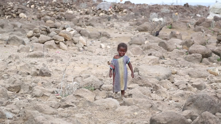 Djibouti / Djibouti - May 2 2014: barefoot poor girl crying and going to her mom.