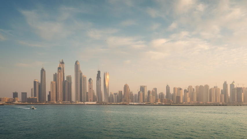 Timelapse of skyscrapers in Dubai Marina, sunset time, UAE   Shutterstock HD Video #1037248310