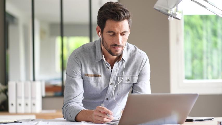 Modern man working in office #1037266790