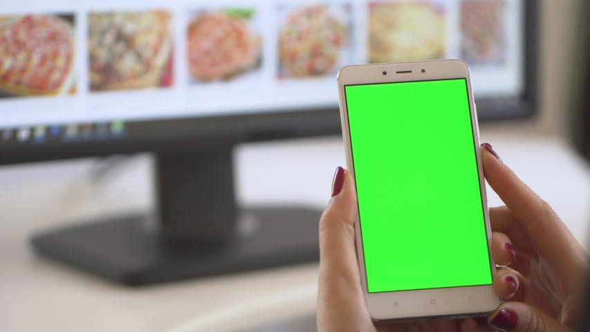 Business woman using smartphone viewing green screen on mobile phone browsing chroma key online watching enjoying drinking coffee reading social media close up hands. Shopping on the Internet. | Shutterstock HD Video #1037289947