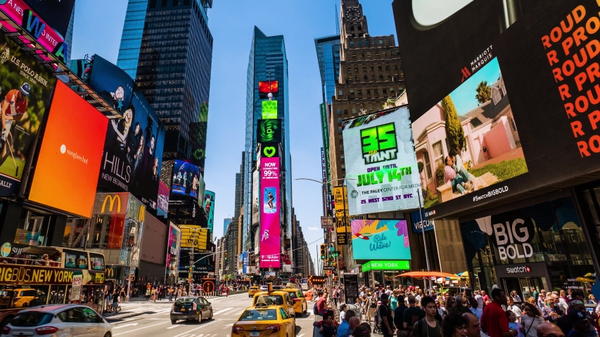Times Square New York City Daytime Timelapse. High dynamic range 4K super fine timelapseby raw photo files. Crazy busy people, traffic and LED walls of advertisements. New York,
