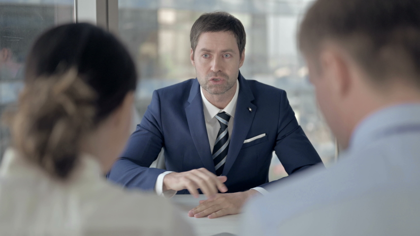 Angry Middle Aged Businessman Talking with Employees at Work | Shutterstock HD Video #1037296532