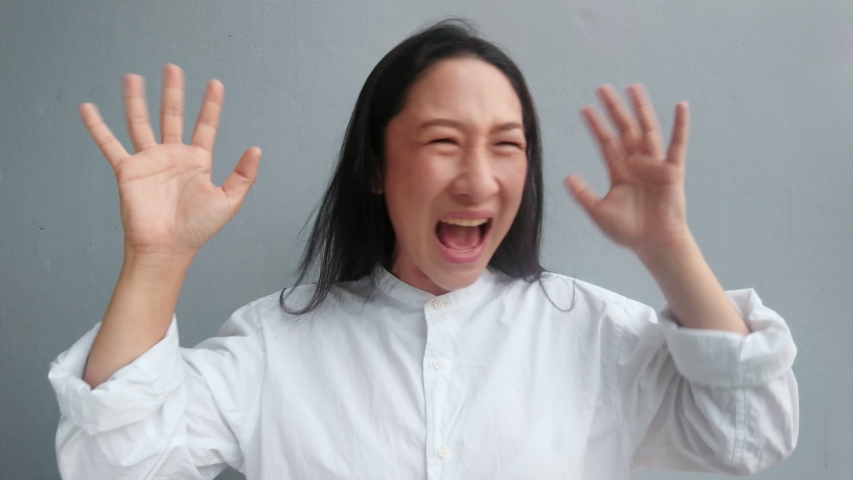 Business Asian woman feeling Wow and glad Overjoyed . Asian woman with Black hair showing joyful emotion such as be smile,love,wow,surprise,excellent,Happy   | Shutterstock HD Video #1037306492