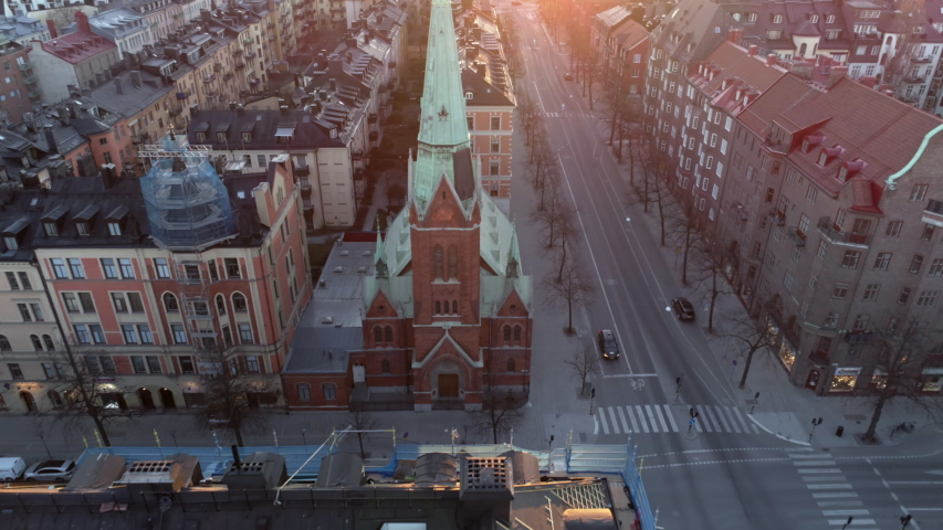 Empty street in Stockholm city, Sweden aerial top down view. Quarantined city, empty abandoned streets during corona virus outbreak. Drone shot flying over buildings and street at sunset Royalty-Free Stock Footage #1037310566