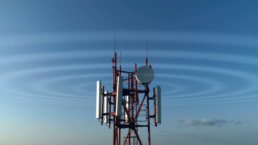 Closeup aerial view around of the telecommunication tower. Telecom tower antennas and satellite transmits the signals of cellular 5g 4g mobile signals and their radio waves works on a long distance. Royalty-Free Stock Footage #1037314223