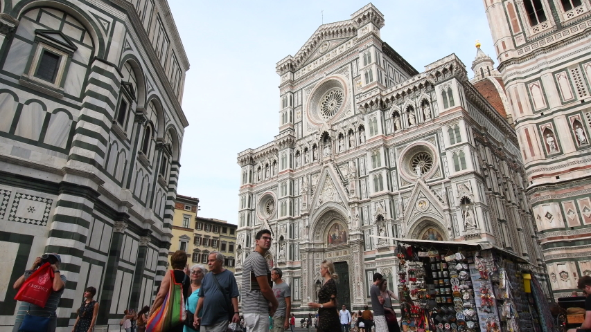 Florence, September 2019: Tourists in in front of Cathedral of Saint Mary of the Flower (Cattedrale di Santa Maria del Fiore). Is the Cathedral of Florence, Italy. 4K UHD Video. | Shutterstock HD Video #1037330288