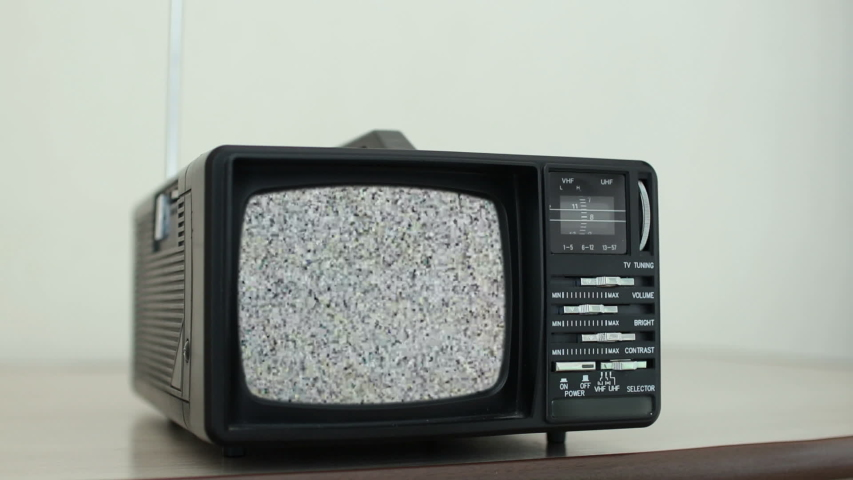 White noise on analogue TV set in room | Shutterstock HD Video #1037332325