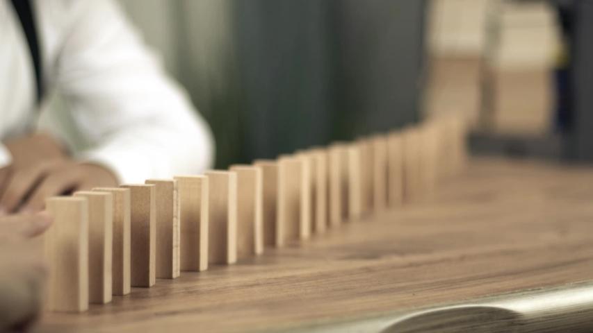 Wooden blocks falling in line domino effect | Shutterstock HD Video #1037333087