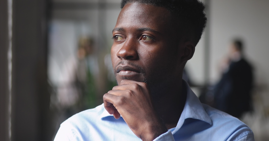 Thoughtful serious african american businessman executive looking away thinking of future challenges ideas leadership opportunities, dream of success new goals, business vision concept, close up view Royalty-Free Stock Footage #1037333399