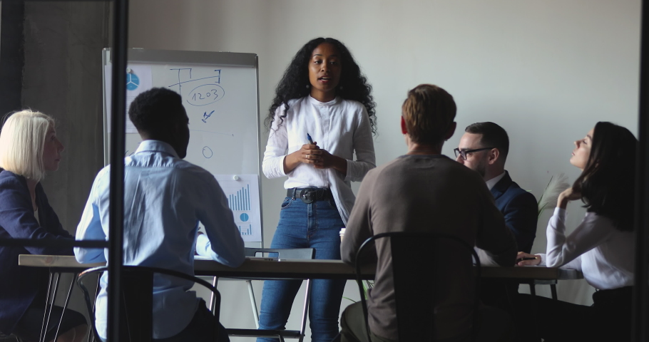 African business woman manager coach leading business meeting give flip chart presentation training consulting work group, mixed race mentor leader teach diverse people at corporate workshop concept Royalty-Free Stock Footage #1037333552